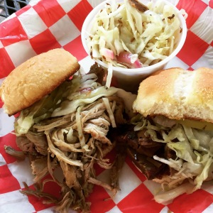 Pulled pork and brisket sliders at Hubba Hubba. Served with a side of warm Asian slaw.